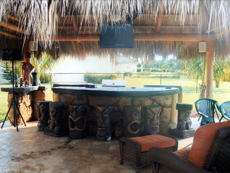 custom tiki hut bar with stools